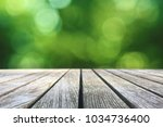 wood picnic table texture over... | Shutterstock . vector #1034736400