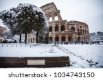 a lovely day of snow in rome ... | Shutterstock . vector #1034743150