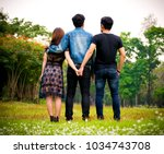 Love Triangle. Young Woman In...