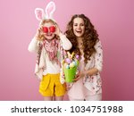 pink mood. happy stylish mother ...   Shutterstock . vector #1034751988
