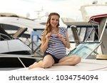 pretty stylish pregnant young... | Shutterstock . vector #1034754094