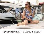 pretty stylish pregnant young... | Shutterstock . vector #1034754100