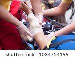 first aid. hand bandaging. | Shutterstock . vector #1034754199