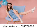 a girl in a blue dress in a...   Shutterstock . vector #1034760328