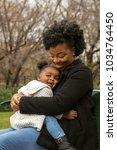 happy african american mother... | Shutterstock . vector #1034764450