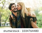 young couple enjoying spring in ... | Shutterstock . vector #1034764480