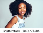smiling young african girl with ... | Shutterstock . vector #1034771686