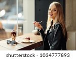 pretty girl hold a plate of... | Shutterstock . vector #1034777893