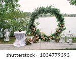 beautiful round wedding arch... | Shutterstock . vector #1034779393