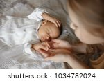 blonde little girl and 1 month... | Shutterstock . vector #1034782024