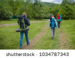 three people on the trail go...   Shutterstock . vector #1034787343