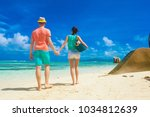 couple in bright clothes on a... | Shutterstock . vector #1034812639