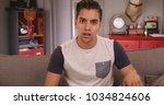 young millennial hispanic man... | Shutterstock . vector #1034824606