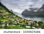 norway fiord landscape  ... | Shutterstock . vector #1034825686