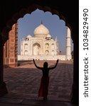 tourist standing near the taj... | Shutterstock . vector #1034829490