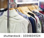 fashionable clothes on hangers... | Shutterstock . vector #1034834524
