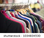 fashionable clothes on hangers... | Shutterstock . vector #1034834530