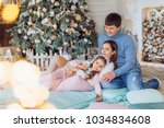 happy little girl with mom and... | Shutterstock . vector #1034834608