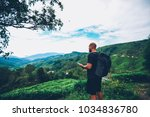 male tourist with black... | Shutterstock . vector #1034836780