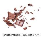 chocolate broken into pieces in ... | Shutterstock . vector #1034857774