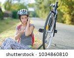 beautiful girl with a bike... | Shutterstock . vector #1034860810