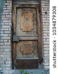 Small photo of wall, concrete, old, texture, background, plaster, grey, pale, urban, city, rough, structure, grain, fabric, split; crack; cleft; crevice; chap, house, door, porch, entrance, closed door, lock