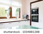 modern house kitchen with white ... | Shutterstock . vector #1034881288