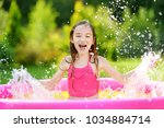 adorable little girl playing in ... | Shutterstock . vector #1034884714