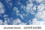 a photo straight up at the sky   Shutterstock . vector #1034916580