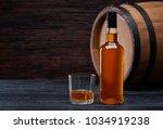 bottle of whiskey on... | Shutterstock . vector #1034919238