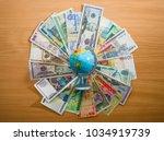 globe map sign over many... | Shutterstock . vector #1034919739
