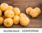 yellow potato on the wooden... | Shutterstock . vector #1034920960