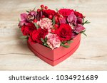 red gift box with flowers at... | Shutterstock . vector #1034921689