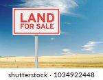 land for sale sign against... | Shutterstock . vector #1034922448