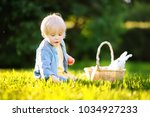 charming little boy hunting for ... | Shutterstock . vector #1034927233