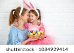 happy easter  family mother and ...   Shutterstock . vector #1034929414