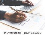 business women reviewing data... | Shutterstock . vector #1034931310