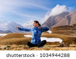 woman tourist is sitting on the ... | Shutterstock . vector #1034944288