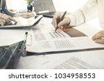 business team meeting... | Shutterstock . vector #1034958553