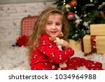 curly haired girl in red... | Shutterstock . vector #1034964988
