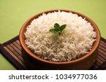 cooked plain white basmati rice ... | Shutterstock . vector #1034977036