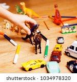 children playing toys on floor... | Shutterstock . vector #1034978320