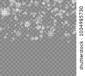 falling snowflakes on... | Shutterstock .eps vector #1034985730
