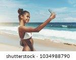 young sexy brazilian model girl ... | Shutterstock . vector #1034988790