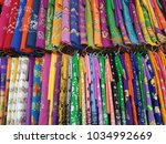 heap of colorful cloth fabrics... | Shutterstock . vector #1034992669
