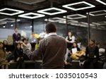 man presenting to group of... | Shutterstock . vector #1035010543