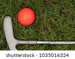 orange golf ball and putter on... | Shutterstock . vector #1035016324