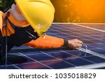 installing a solar cell on a... | Shutterstock . vector #1035018829