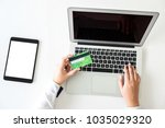 business woman holding credit... | Shutterstock . vector #1035029320