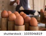 raw egg stand on table in... | Shutterstock . vector #1035046819